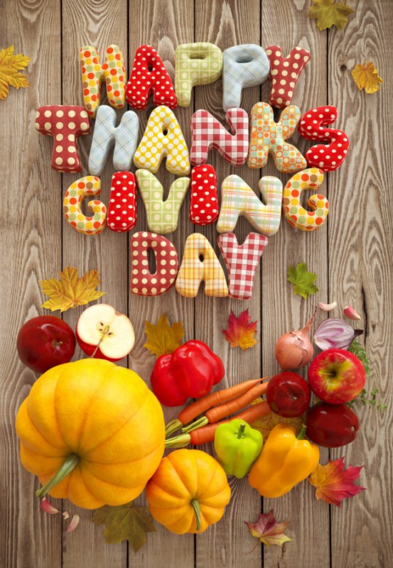 Happy Thanksgiving, America! - Autumn Thanksgiving Day composition with handmade text, fruits and vegetables on wooden background.